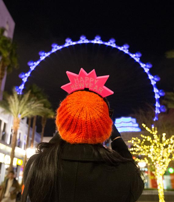 A visitor at The LINQ Promenade snaps a photo of the High Roller during New Year's Eve