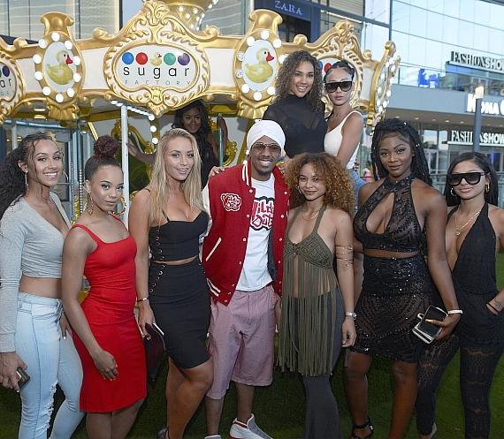 Nick Cannon and the Wild N Out girls hanging outside at the Sugar Factory Carousel