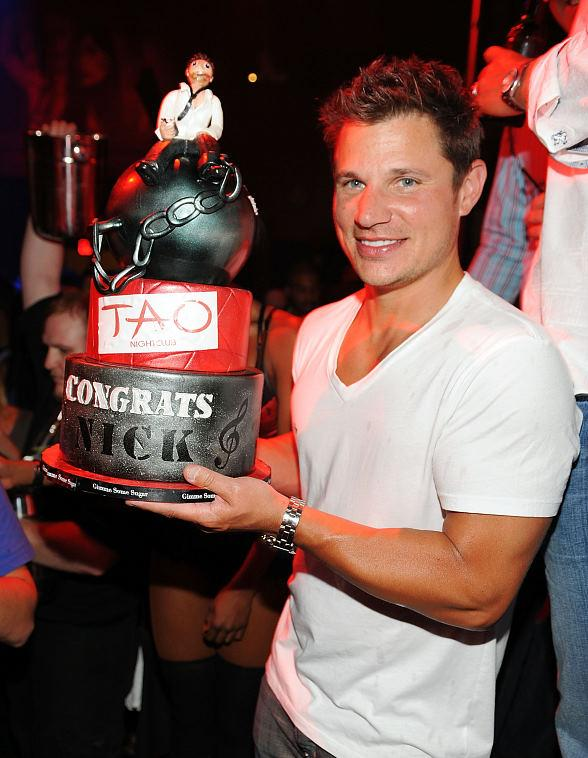 Nick Lachey with cake at TAO