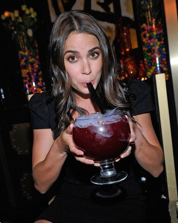 Nikki Reed with Berry Bliss goblet-sized cocktail at Sugar Factory American Brasserie