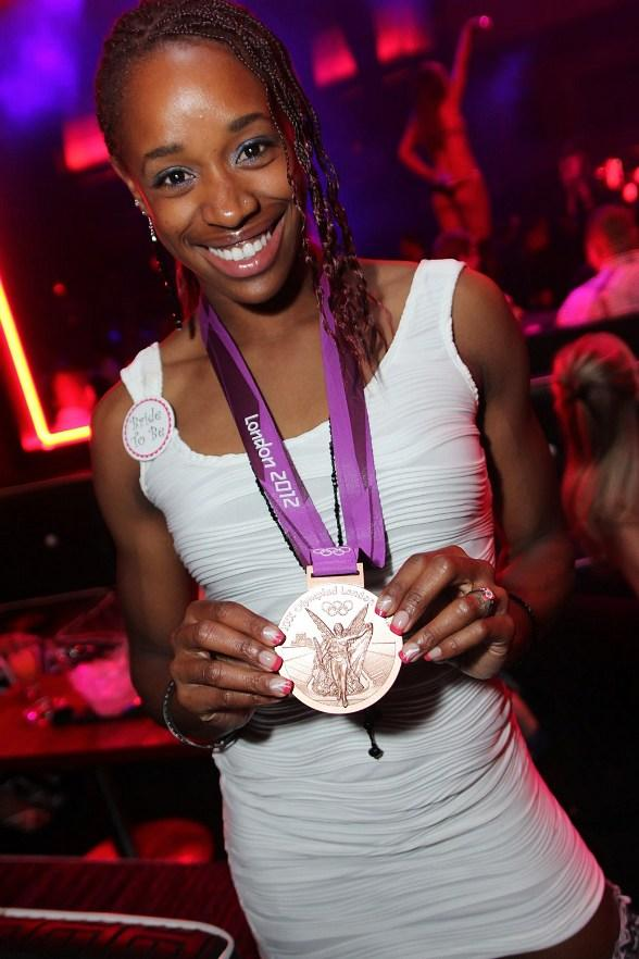 Olympian Janay DeLoach with her Olympic medal at Rain Nightclub