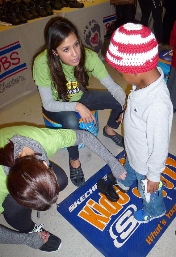 A child is measured for new shoes  at the BOBS from Skechers event at  Variety Early Learning Center