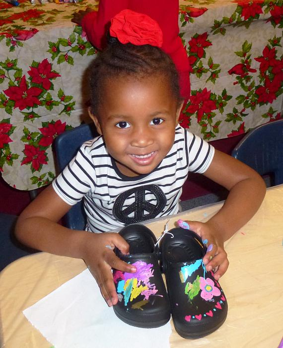 A child with the BOBS from SKECHERS shoes that she decorated herself