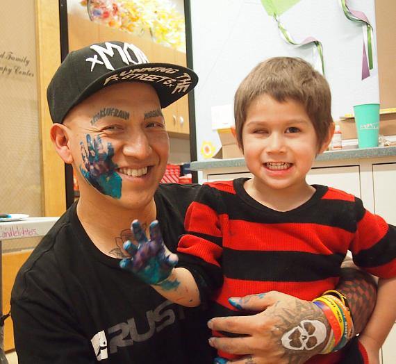Featured artist Kitos Lucero collaborated with 3-year-old King Magana, a cancer survivor, Candlelighters beneficiary and Evening of Hope honoree, to create a graffiti masterpiece for the live auction.