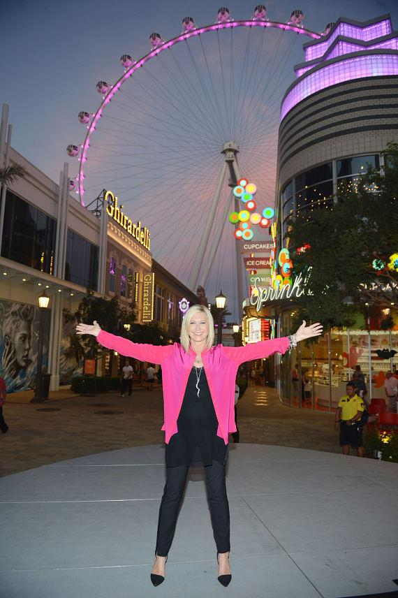 Flamingo Las Vegas headliner Olivia Newton-John lights the world's tallest observation wheel, the High Roller at The LINQ Promenade in Las Vegas, pink in honor of Breast Cancer Awareness Month on Monday, Oct. 6