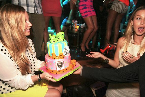 Paige and Whitney Port having fun with the birthday cake