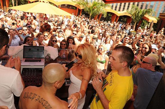 Pam Anderson in TAO Beach DJ booth
