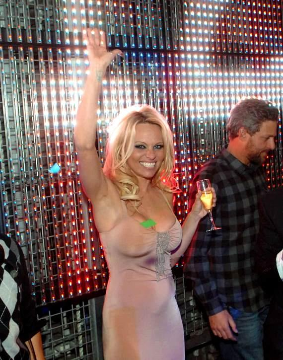Pamela Anderson toasting to the New Year at Studio 54