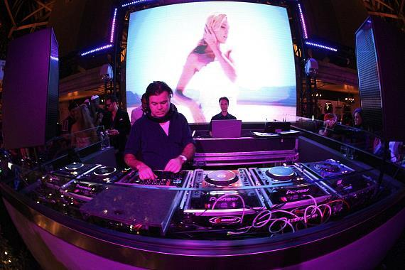 Paul Oakenfold spins at Chateau Gardens, with the Butterfly screen in the background