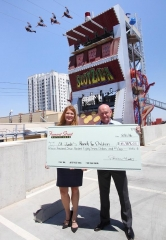Fremont Street Experience Presents St. Jude's Ranch for Children a Check for $15,787 from SlotZilla Charity Challenge