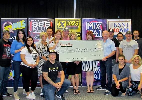 CBS RADIO DJ's from 98.5 KLUC, Mix 94.1, Q100.5, X107.5, and Newstalk 840AM KXNT and Patrick Hughes, President of Fremont Street Experience present a check for $15,787 to St. Jude's Ranch for Children. The proceeds were raised from SlotZilla revenue on August 1, 2016 from noon to 6 p.m. CBS Radio DJ's from all stations were on-site for live remotes during the event.