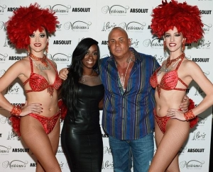 Steve Martorano and Marsha Martorano pose with dancers from Jubilee at the Grand Opening of Martorano's at Paris Las Vegas