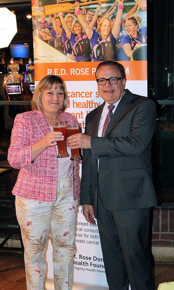 Boyd Gaming Vice Chairman, Executive VP and Chief Diversity Officer Marianne Johnson pictured with Charlie Guida, President of St. Rose Dominican Health Foundation at Red Rose Brew unveiling