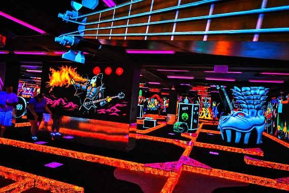 "KISS By Monster Mini Golf is a 14,000 square-foot ""KISS themed"" attraction that showcases an indoor glow-in-the-dark custom-designed, rockin' 18-hole miniature golf course filled with state-of-the-art video & animatronics, and never-seen-before KISS props"