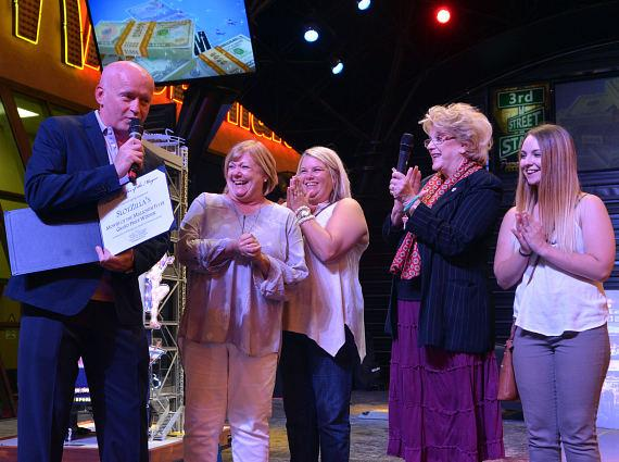 Pamella Siegel received $1,000, a year of free flights on the SlotZilla, a plaque, and special recognition from Las Vegas Mayor Carolyn G. Goodman during a special ceremony to recognize Siegel as SlotZilla's Month of the Millionth Flyer Grand Prize Winner. Pictured: Patrick Hughes, President and CEO of Fremont Street Experience, Pamella Siegel, Heather Wagy, Las Vegas Mayor Carolyn G. Goodman, and Emilie Wagy