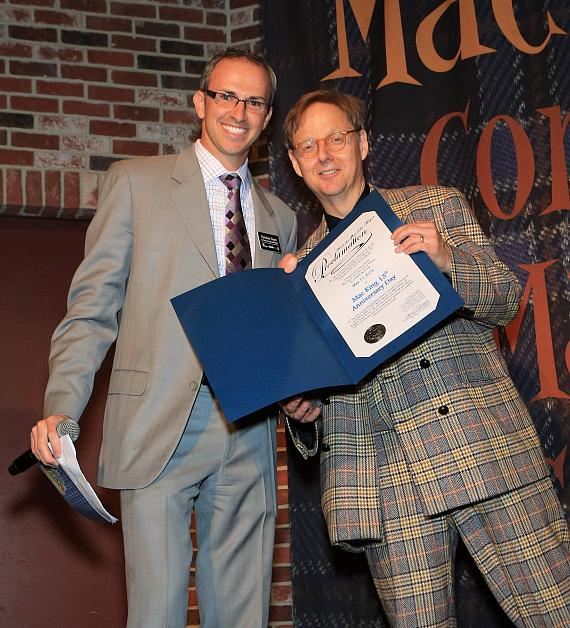 "Christian Stuart, Harrah's regional vice president and assistant general manager presents Comedy-Magician Mac King with a proclamation from Mayor Carolyn G. Goodman naming May 11, 2013 ""Mac King 13th Anniversary Day"" in Las Vegas."