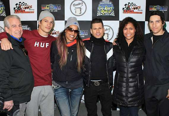 Rasheda Ali (3rd from left) and the Ali-Walsh family with Mike Hammer