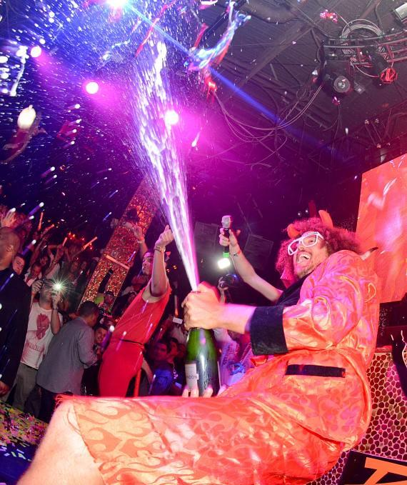 Redfoo sprays champagne at TAO