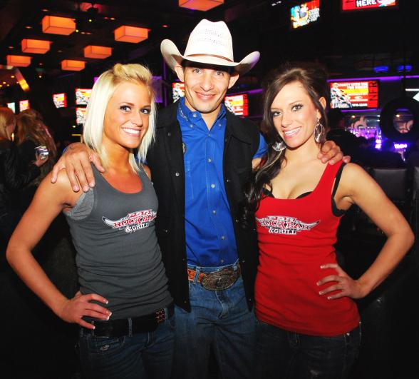 2010 PBR World Champion Renato Nunes with PBR Rock Bar girls Trina Naughton and Jena Carpin