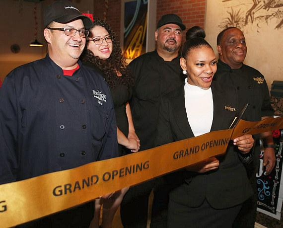 Members of The Wrangler Grill team celebrate the ribbon cutting at the Grand Opening Nov.1 , 2017. From left to right: Executive Chef Carlos Pineiro, Marketing Director Elva Caro, Sous Chef Fiji Chand, Restaurant Supervisor Kimberly Swanson, Executive Sous Chef Neil Williams