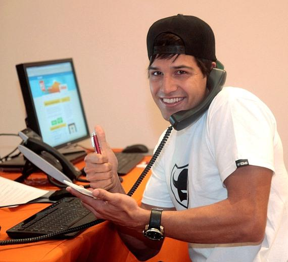 Ricardo Laguna answers phones at Nevada's Big Give Headquarters at Miracle Mile Shops