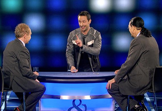 Magician Rick Lax performs a card trick for Penn & Teller
