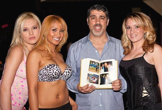 """Gary Dell'Abate with Rick's Cabaret Girls and his book """"They Call Me Baba Booey"""""""