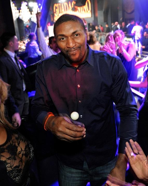 Ron Artest inside Chateau Nightclub & Gardens with a Sugar Factory couture lollipop