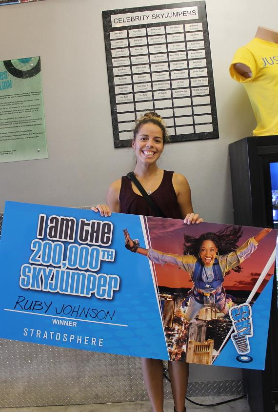 Ruby J., Stratosphere's 200,000th SkypJumper poses in front of the Celebrity Jumper Plaque