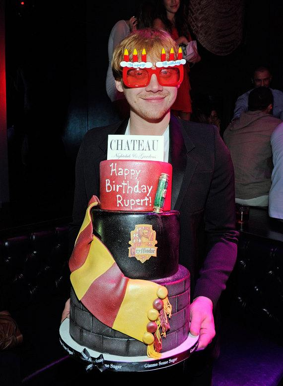 "upert Grint with ""Harry Potter"" themed red velvet birthday cake at Chateau Nightclub & Gardens"