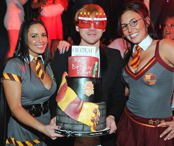 "Rupert Grint with VIP cocktail waitresses dressed in ""Harry Potter"" costumes at Chateau Nightclub & Gardens"
