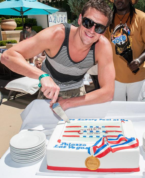 Ryan Lochte cuts The Palazzo Las Vegas cake courtesy of Carlo's Bakery at The Venetian