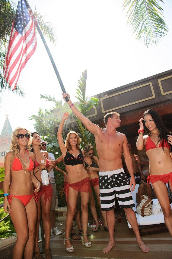 Ryan Lochte waives American flag at TAO Beach
