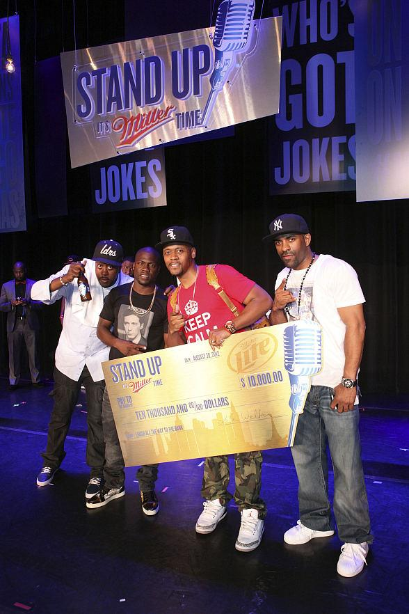 Grand prize winner Lavar Walker of New Orleans with Kevin Hart and other contestants