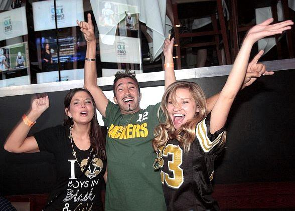 Saints and Packers Fans Cheering at Lagasse