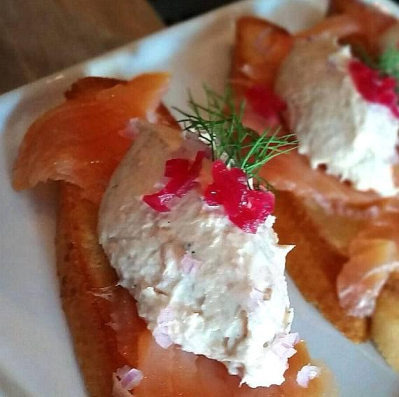 Salmon mousse with smoked salmon, pickled peppers and bruniose cut red onions