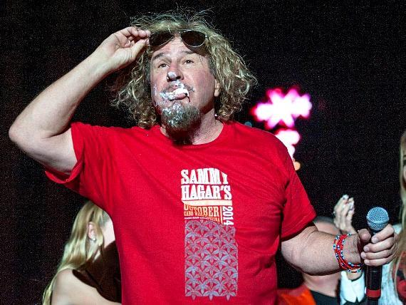 Sammy Hagar enjoys his birthday cake on stage