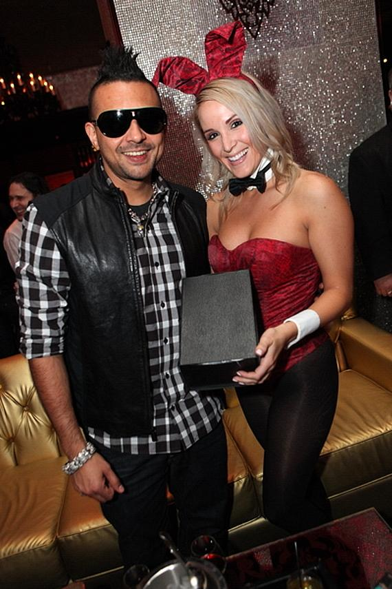Sean Paul receiving key from Playboy Bunny at Playboy Club