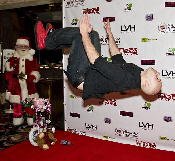 Santa watches as Seth Gabel does a backflip
