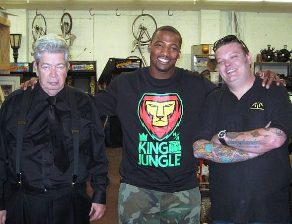 "San Diego Charger Shaun Phillips (c) visits the ""Pawn Stars"" Old Man (l) and Corey ""Big Hoss"" Harrison at Gold & Silver Pawn"