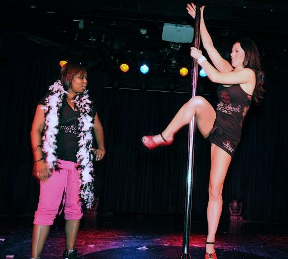 Tracey teaches another pole dancing move to Shar Jackson