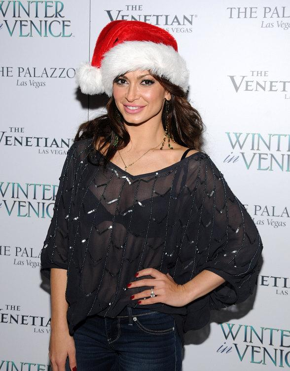 Dancing Star Karina Smirnoff walks the white carpet at Winter In Venice