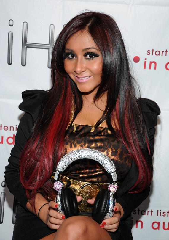 Jersey Shore's Nicole 'Snooki' Polizzi promotes headphones at iHip Booth at CES Show in Las Vegas