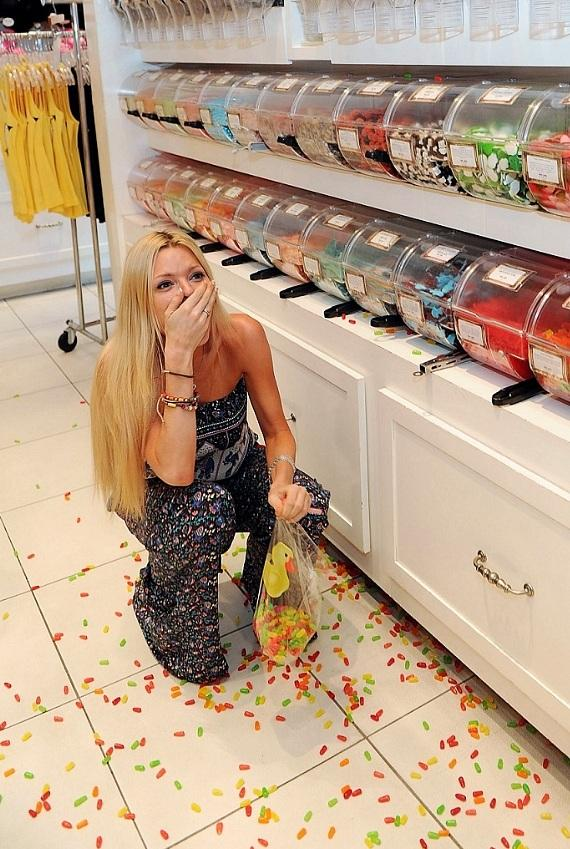 Sophie Monk laughing at her sweet candy blunder