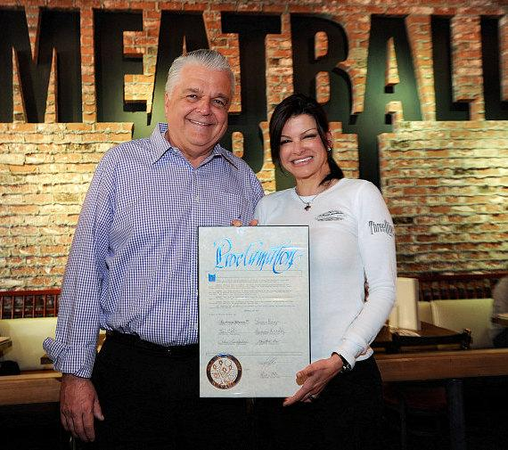 "Clark County Commissioner, Steve Sisolak, presenting ""Meatball Spot Day"" proclamation to Carla Pellegrino inside Meatball Spot"
