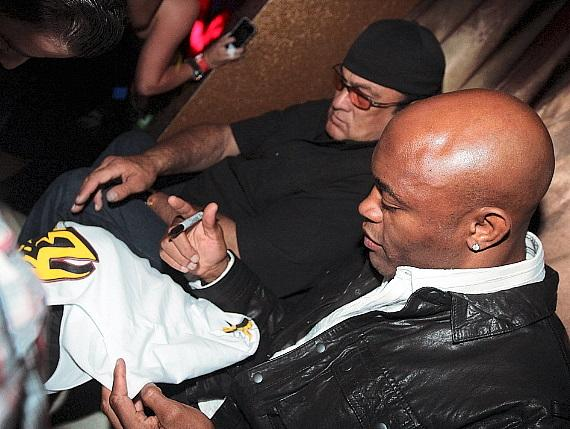 Steven Seagal and Anderson Silva sign autographs