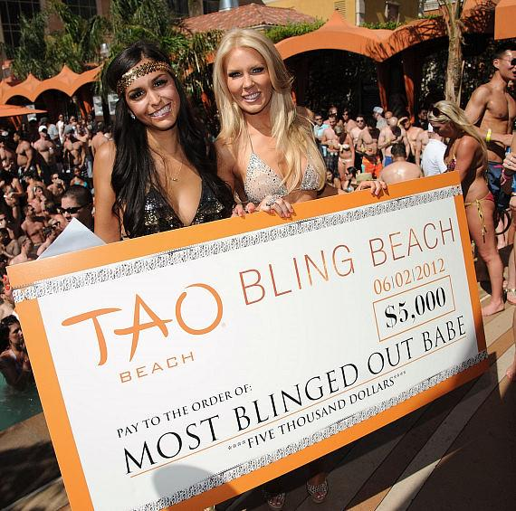 Gretchen Christine Rossi presents check to Bling Beach Winner