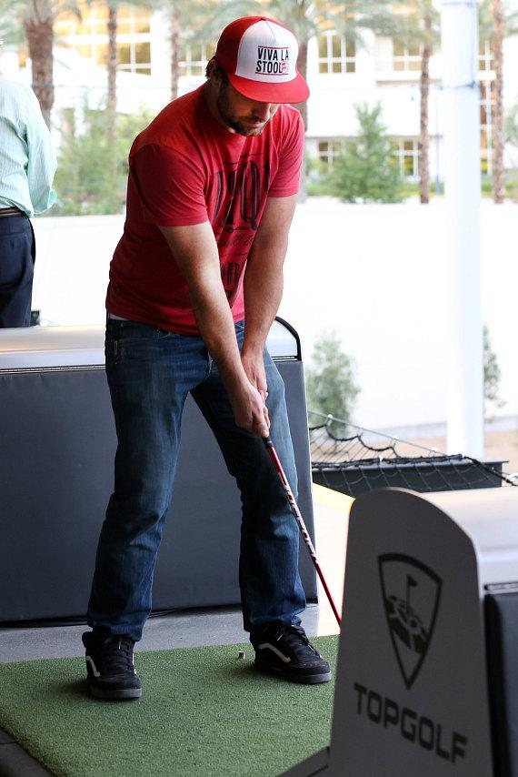 TJ Lavin plays golf at Topgolf
