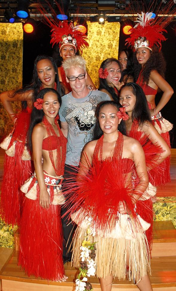 Murray SawChuck in Tahiti surrounded by beautiful Tahitian women