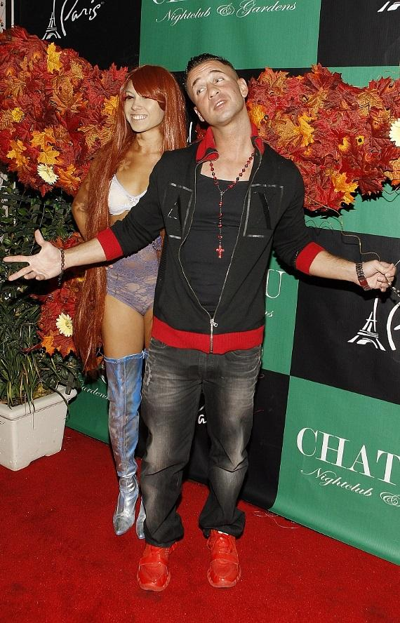 """Mike """"The Situation"""" Sorrentino with Butterfly girl on Chateau Gardens red carpet"""